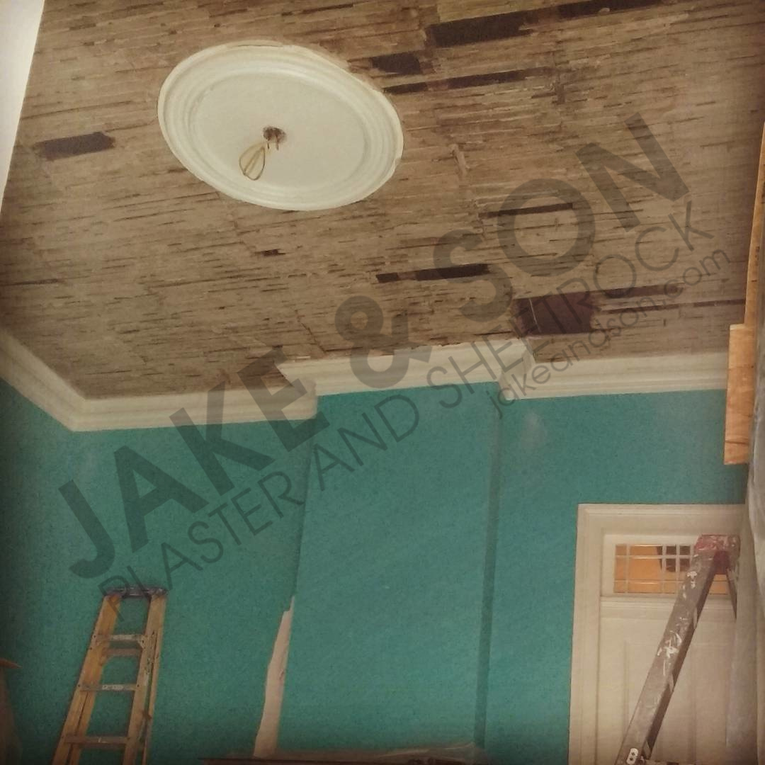 Large plaster ceiling removed, showing just the lathe